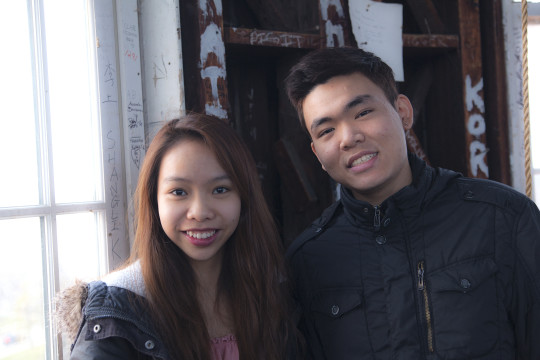 Hailie Nguyen and Phong Le pose for a photograph.