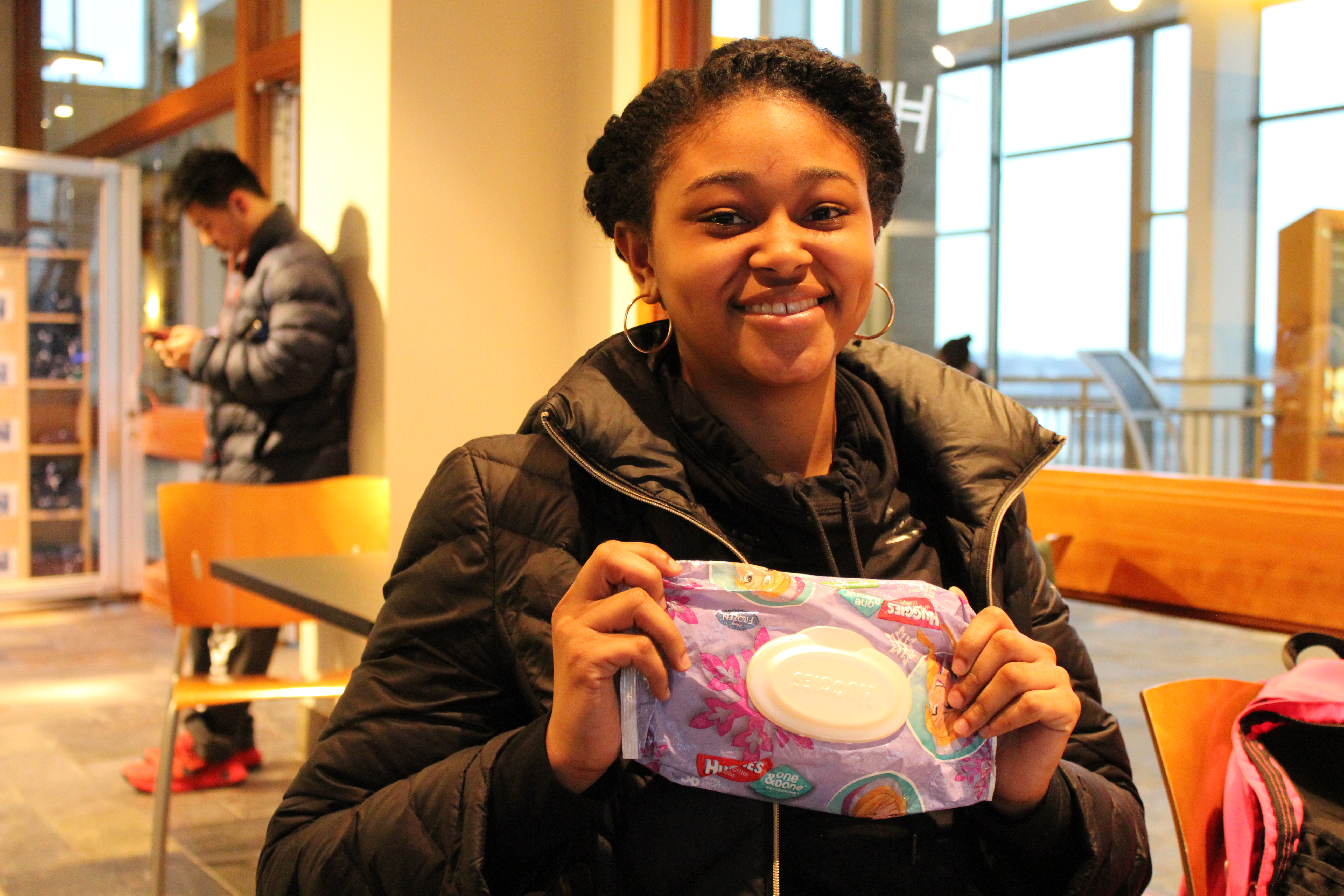 """It's easier than getting a papertowel,"" said freshman Briana Faulkes, holding Huggies baby wipes."
