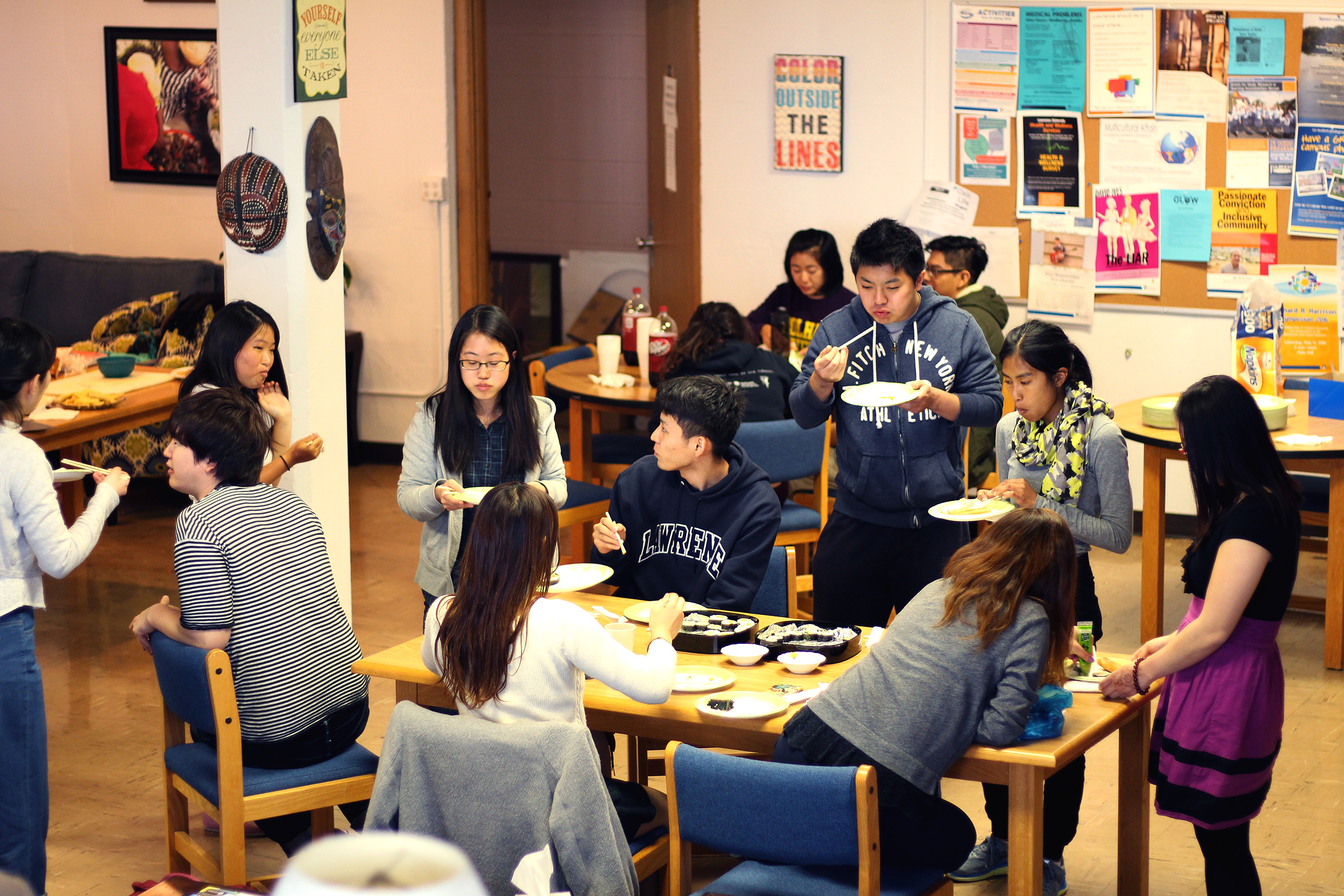 Students enjoy rolls and conversation in the Diversity Center.
