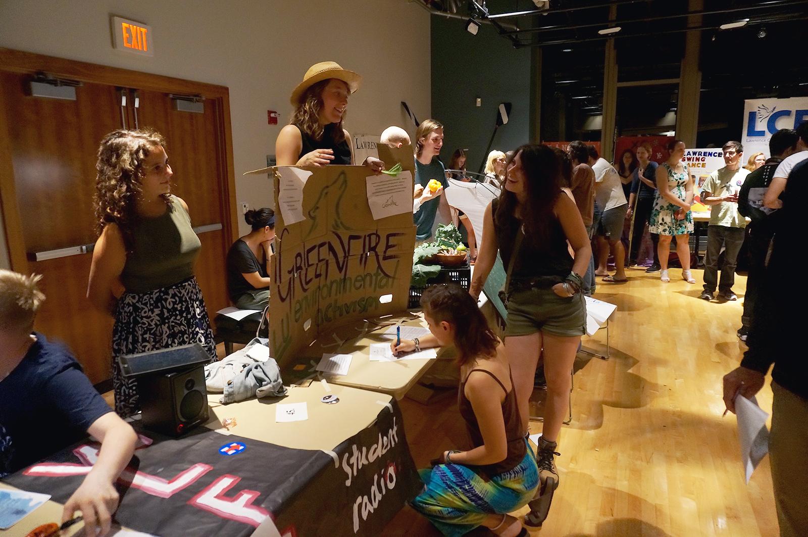 Greenfire members talk to potential new members.