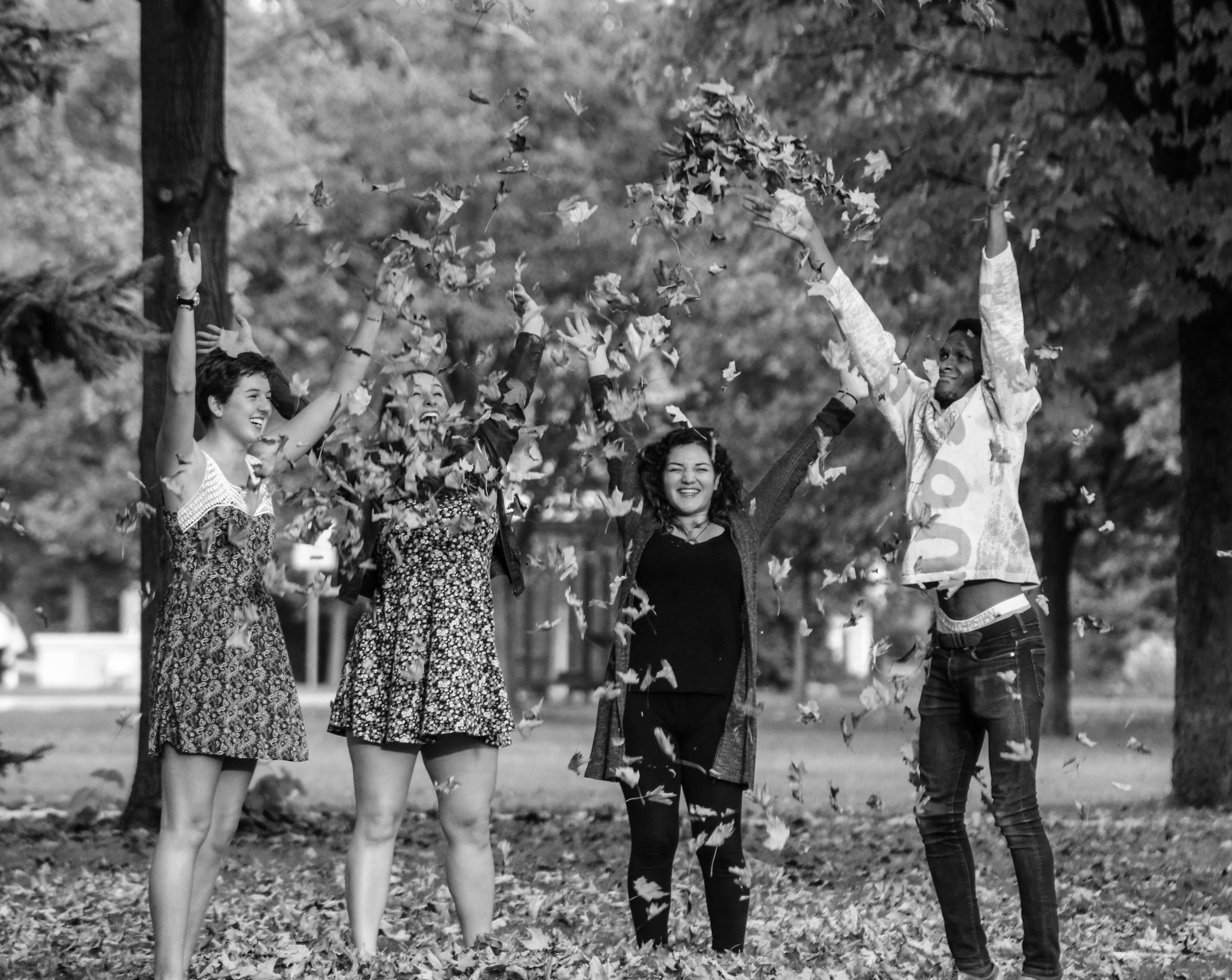 Juniors Delaney Olsen, Madeleine Moran, Sally Alvarado and Jamil Fuller relish the autumn weather during Fall Festival. Photo by Allegra Taylor