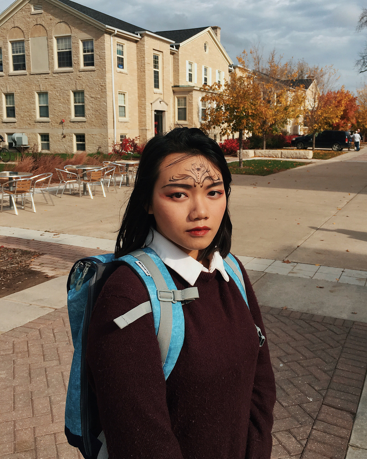 """I like to draw something cool on my face and walk around campus,"" shares sophomore Trang Doan about her makeup. Photo by Ben Tran"