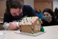 Masked student doctorates gingerbread house