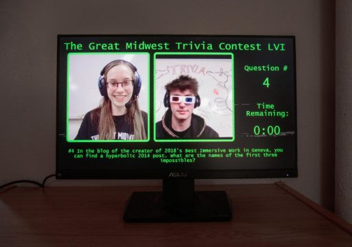 Computer screen displaying two people and information about contest